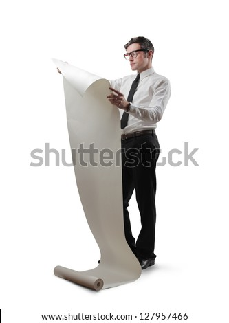 businessman reads the paper roll - stock photo