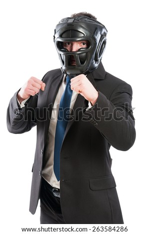 Businessman ready for takeover concept with male wearing protective boxing helmet - stock photo