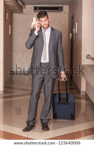 Businessman ready to Depart with Trolley - stock photo