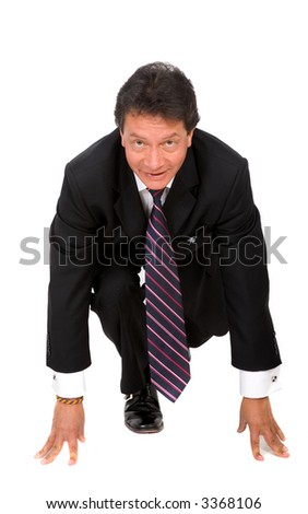 businessman ready to race - start his own business - isolated over a white background - stock photo
