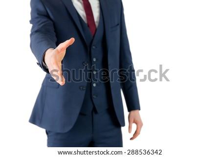 Businessman ready to shake hand on white background - stock photo
