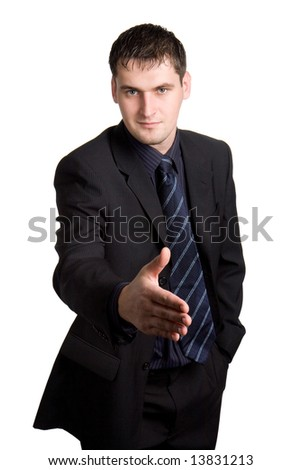 Businessman ready to shake hands - stock photo