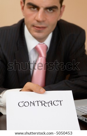 businessman ready to sign contract, shallow dof