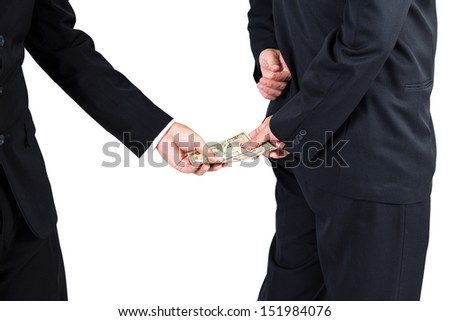 Businessman receive money by his back concept for corruption - stock photo