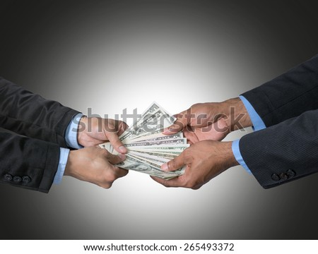 Businessman receiving the money offered by businessman on dark blue background,include clipping path - stock photo