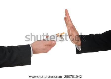 Businessman Refusing Cigarette Offered By His Colleague - stock photo