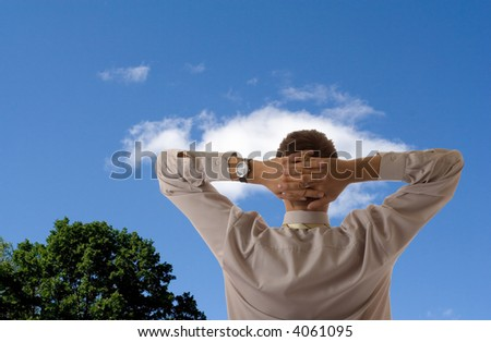 businessman relax blue sky and tree on blue sky background