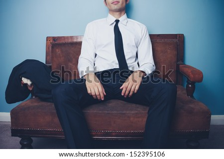 Businessman relaxing after long day at work - stock photo