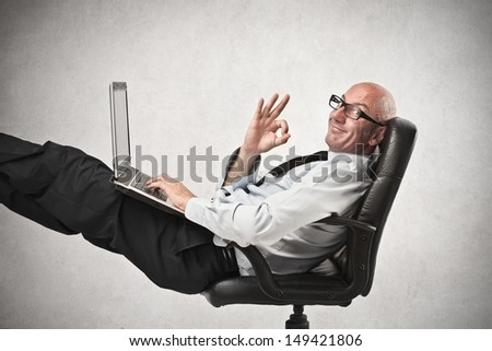 businessman relaxing at the office - stock photo