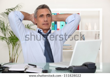 businessman relaxing in his office - stock photo