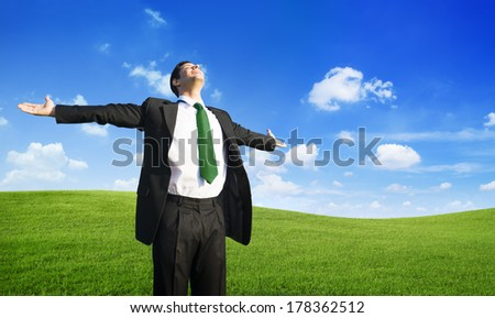 Businessman Relaxing on a Hill