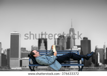 Businessman relaxing with a book