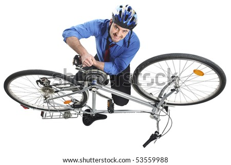 businessman repai his bicycle isolated on white - stock photo