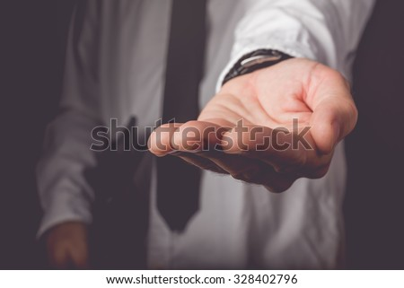Businessman requesting for money loan, retro toned image, selective focus - stock photo