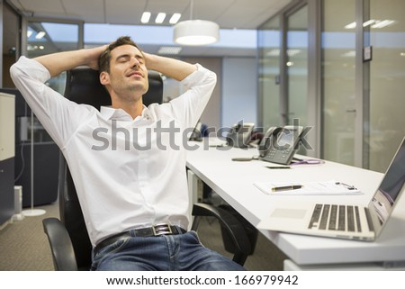 Businessman resting at his office - stock photo
