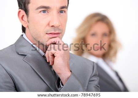 Businessman resting his hand on his chin - stock photo
