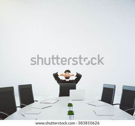 Businessman resting on the chair in conference room with oval table and chairs, 3D Render - stock photo