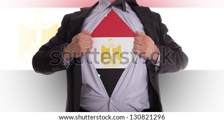 Businessman rips open his shirt to show his Egyptian flag t-shirt - stock photo