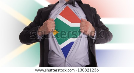 businessman rips open his shirt to show his South African flag t-shirt - stock photo