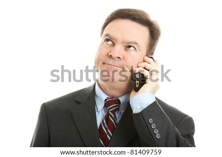 Businessman rolling his eyes as he listens to a boring phone call or message.  Isolated on white. - stock photo