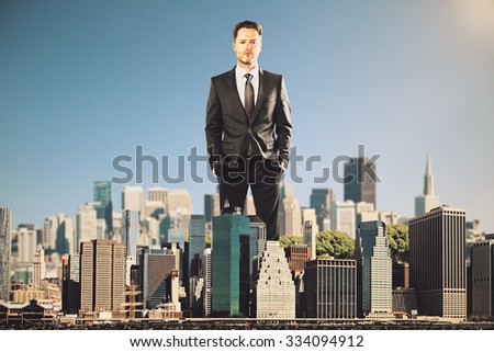 Businessman rules the city concept - stock photo