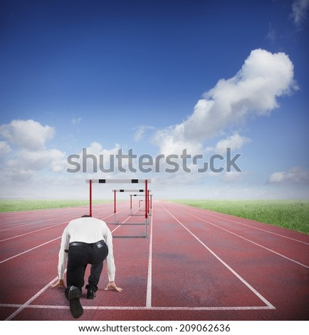 Businessman run to jumping business obstacles in a track - stock photo