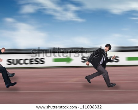 Businessman run to success - stock photo