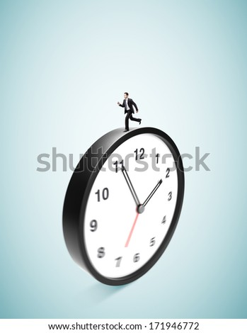 businessman runing on clock on ablue background