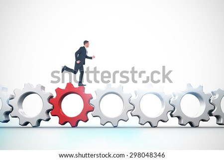 Businessman running against red and white cogs and wheels - stock photo