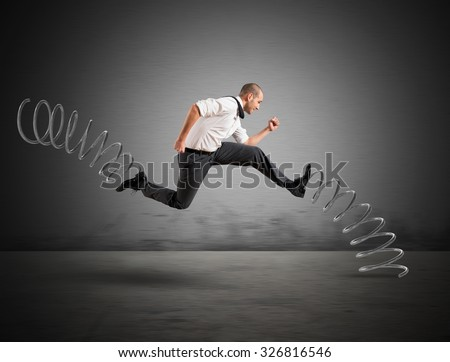Businessman running fast with the big springs