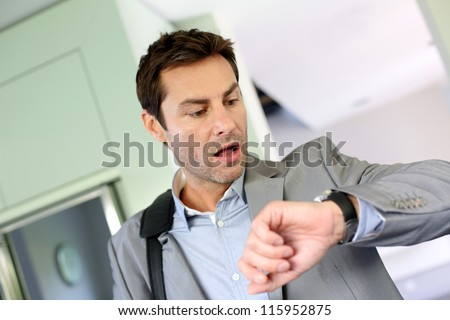 Businessman running late for work