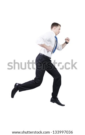 Businessman running late for work, jumping while walking