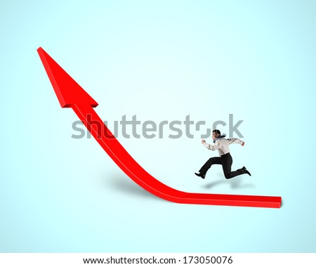 Businessman running on growing red arrow in green background