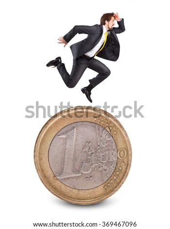 Businessman running on the one euro coin and look forward - stock photo