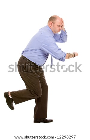 Businessman running to his next meeting with his eyes on his watches - stock photo