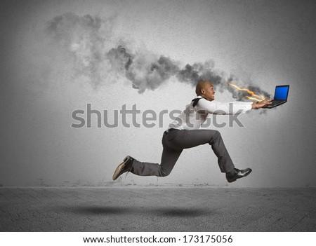 Businessman running with blue screen computer error - stock photo