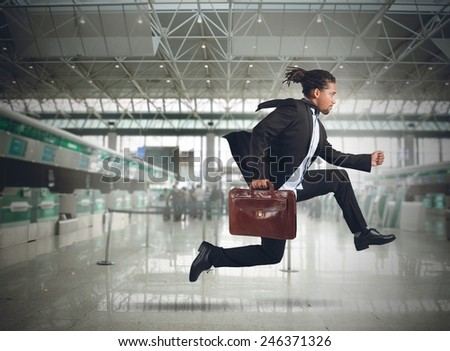 Businessman runs in the airport because late - stock photo