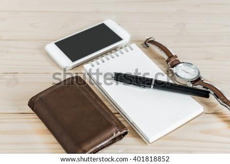 businessman's accessories, notepaper, pen, wristwatch, wallet, smart phone - stock photo