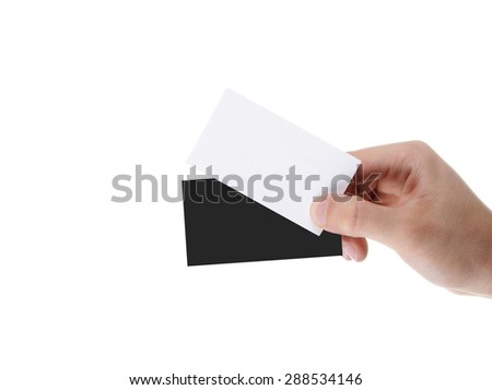 Businessman's hand holding blank and black paper business card - stock photo