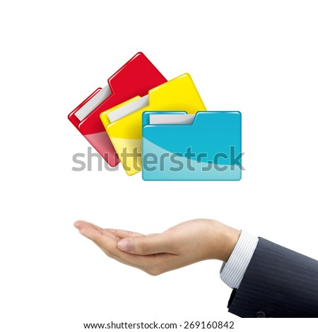 businessman's hand holding colorful folders over white background - stock photo