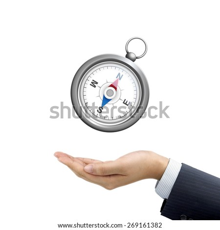 businessman's hand holding compass over white background - stock photo