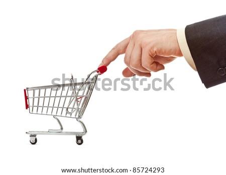 businessman's hand pushes shopping cart - stock photo