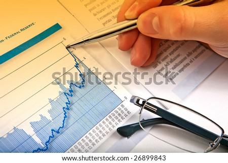 Businessman's hand showing diagram on financial report with pen. Business background 08 - stock photo