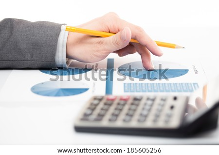 Businessman's hand showing financial report on table - stock photo