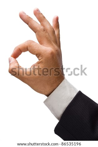 Businessman's hand showing OK sign. - stock photo