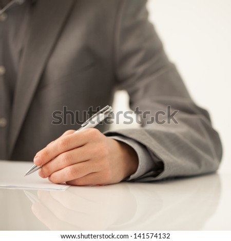 Businessman's hand signing a document.