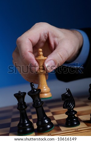 businessman's hand  with chess