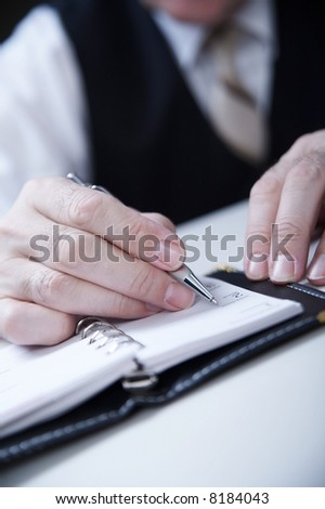 businessman's hand  with pan - stock photo