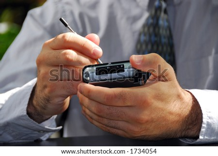 Businessman's hands holding pda - stock photo