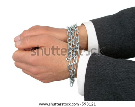 Businessman's Hands In Chains - stock photo